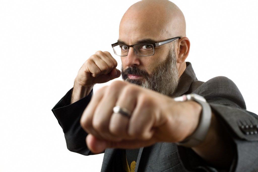 Curt Mercadante punching. Headshot by DreamLight Images, Charleston SC